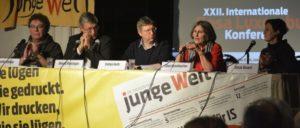 Das Podium bei der Rosa-Luxemburg-Konferenz, v.l.n.r.: Patrik Köbele, Bernd Riexinger, Stefan Huth, Ellen Brombacher, Aitak Barani.  (Foto: Tom Brenner)