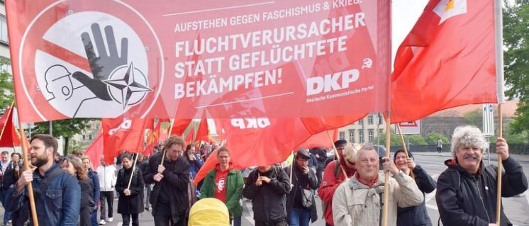 DKP auf der Straße gegen die Migrationspolitik der Bundesregierung (Foto: Uwe Hiksch)