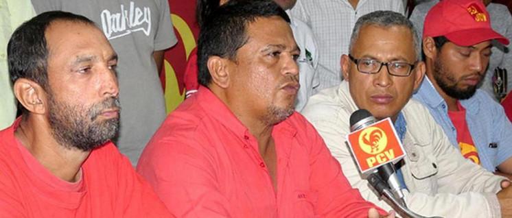 Der ermordete Genosse Luis Fajardo (2. von links) bei einer Pressekonferenz. (Foto: PVC)