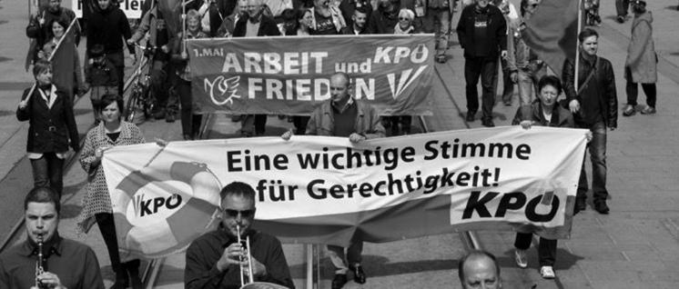 Auf der Straße und im Landtag präsent: KPÖ Steiermark bei der Maidemonstration in Graz, am vorderen Transparent links die Spitzenkandidatin Claudia Klimt-Weithaler.